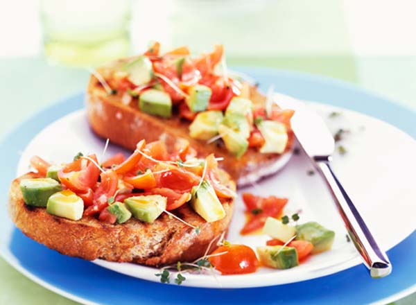 Avocado, tomato and cress on toasted bread