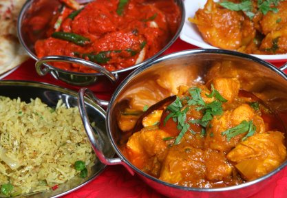 Indian curry meal with rice, nan and begetables