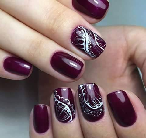 dark-purple-nail-with-white-design
